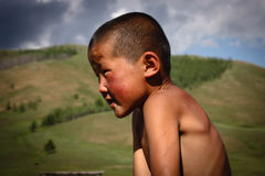 Mongolian Boy. A  photo of a young nomadic mongolian boy Stock Photo