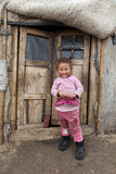 Mongolian child infront of Ger doors Stock Images