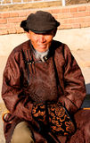 Mongolian costumes. Men dressed in your Pedigree Mongolian costumes stock image