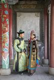 Mongolian couple in traditional outfit. Near old Temple in Ulaanbaatar Stock Photos