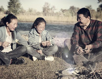Mongolian Family Enjoy Camping River Leisure Concept Stock Images