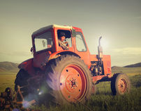Mongolian Farmer Driving Tractor Field Agicultural Concept Royalty Free Stock Images