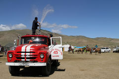 Mongolian Firemen refreshing people Royalty Free Stock Photo