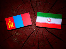 Mongolian flag with Iranian flag on a tree stump isolated Royalty Free Stock Images