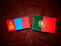 Mongolian flag with Portuguese flag on a tree stump isolated. Mongolian flag with Portuguese flag on a tree stump vector illustration