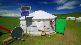 Mongolian ger camps with solar power. TV satellite and oxcart, Central Mongolia. Great contrast, modern and traditional lifestyle melting each other stock video