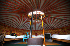 Mongolian ger. The circular Mongolian ger, or yurt, is lined with animal furs for warmth, and provides the traditional living space of the northern Asian country Stock Photo