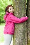 Mongolian girl hugging a tree Royalty Free Stock Photos