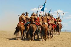 Mongolian horse riders take part in the traditional historical show of Genghis Khan era in Ulaanbaatar, Mongolia. ULAANBAATAR, MONGOLIA - AUGUST 17, 2006 Royalty Free Stock Image