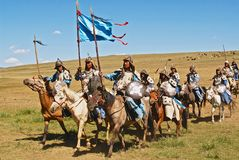 Mongolian horse riders take part in the traditional historical show of Genghis Khan era in Ulaanbaatar, Mongolia. ULAANBAATAR, MONGOLIA - AUGUST 17, 2006 Stock Photo