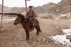 Mongolian horseman and ger camp Stock Image