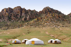 Mongolian jurts at mountain foot. Mongolian jurts camping at the mountain foot royalty free stock photography