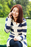 Mongolian lady talking on phone Royalty Free Stock Photo