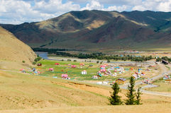 Mongolian landscape with colorful houses. Mongolian landscape with colorful, countryside settlement in a valley outside the capital Ulaanbaatar, Mongolia Stock Image
