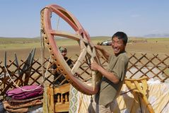 Mongolian man assembles yurt in steppe, circa Harhorin, Mongolia. Royalty Free Stock Photos