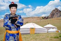 Mongolian man and jurts Stock Photo