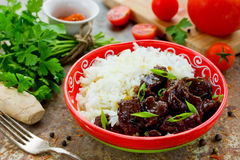 Mongolian meat in sauce with rice. Traditional Asian dish stir-f Stock Image