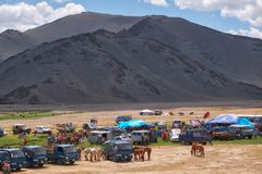 Mongolian nomad camp. Guests came to the national holiday and national wrestling competitions. KHOVD, MONGOLIA - JULY 06, 2017: Mongolian nomad camp. Guests came royalty free stock photography