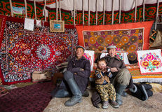 Mongolian nomad father and son in Mongolian yurt Royalty Free Stock Photo