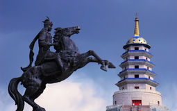 Mongolian pagoda and cavalry. A traditional mongolian pagoda and cavalry statue in xinjiang,China Royalty Free Stock Photography
