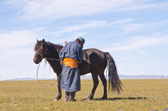 Mongolian people. A mongolian horseman in typical mongolian dress Stock Photo