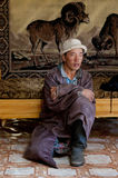 Mongolian people. A mongolian person with is traditional dress in a ger Royalty Free Stock Image