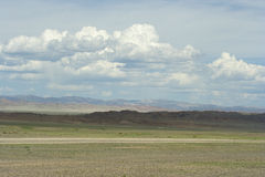 Mongolian roads in the steppe and mountains of Altai. Royalty Free Stock Image