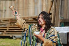 Mongolian shaman performs a ritual in Ulaanbaatar, Mongolia. ULAANBAATAR, MONGOLIA - AUGUST 17, 2006: Unidentified Mongolian shaman performs a ritual in Stock Images