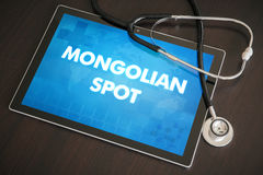 Mongolian spot (cutaneous disease) diagnosis medical concept on. Tablet screen with stethoscope Royalty Free Stock Photos