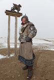 Mongolian warrior dressed in armor Royalty Free Stock Photos