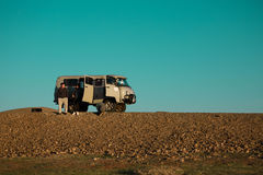 Mongolian on the way to Gobi desert. With old vintage Russia van Stock Photo