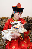 Mongolian woman and baby Stock Photos