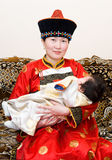 Mongolian woman and baby Stock Photo