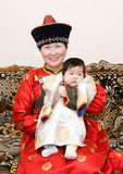 Mongolian woman with baby Royalty Free Stock Photos