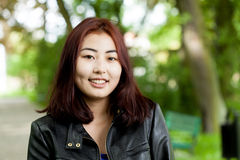 Mongolian woman in park Stock Photo