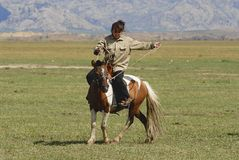Mongolian woman rides on horseback circa Harhorin, Mongolia. Royalty Free Stock Images