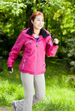 Mongolian woman running in a park Stock Photo
