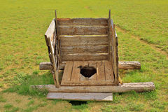 Mongolian wooden squat toilet Stock Photo