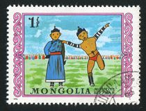 Mongolian wresting. MONGOLIA - CIRCA 1976: stamp printed by Mongolia, shows mongolian wresting, perfomance, circa 1976 Royalty Free Stock Images