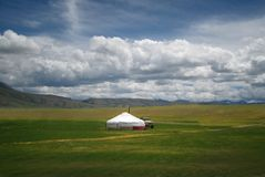 Mongolian yurt, called ger, in a landscape of north-west Mongoli. Green pastures and white clouds Stock Image