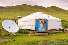 Mongolian yurt on steppe. Traditional Mongolian yurt or ger with satellite dish on grassy steppe of central Mongolia Stock Photo