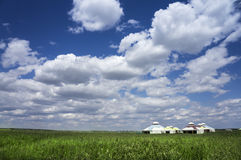 Mongolian yurts on the prairie. Against a blue sky Royalty Free Stock Photography