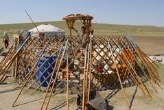 Mongolians assembles yurt in steppe, circa Harhorin, Mongolia. Stock Photography