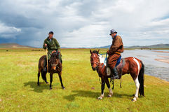 Mongolians in national clothes Stock Images
