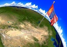 Mongoliet nationsflagga som markerar landsläget på världskarta Royaltyfria Foton