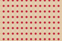 Monica. Textile pattern in a red and beige mixture of colours with interesting geometries Royalty Free Stock Image