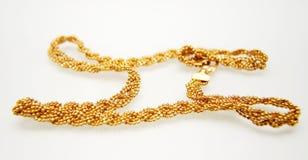 Monili dell'oro giallo Immagini Stock