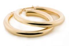 Monili dell'oro - orecchini Immagine Stock