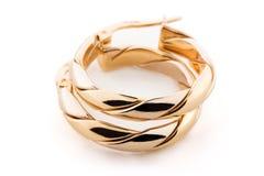 Monili dell'oro - orecchini Fotografie Stock