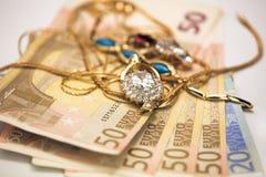 Monili e soldi Fotografia Stock